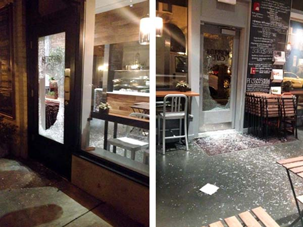 Around 4:40 a.m., security cameras caught a male criminal heaving a huge rock through the glass front door of the cafe.