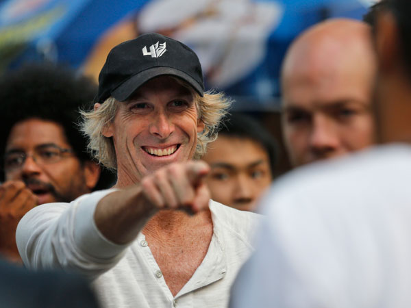 "American film director Michael Bay gestures during the filming of a scene for their latest movie ""Transformers 4: Age of Extinction"" in Hong Kong Saturday, Oct. 19, 2013. (AP Photo/Kin Cheung)"