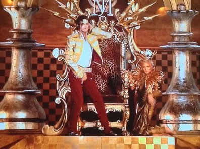 The Michael Jackson hologram grabs its crotch.