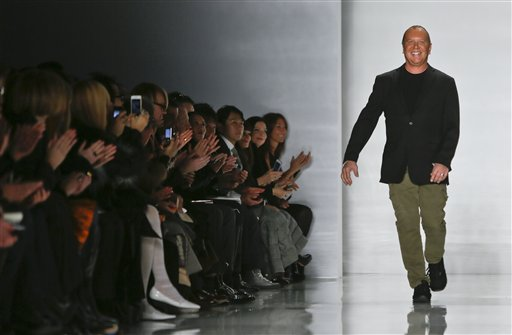 Fashion designer Michael Kors reacts to applause after showing his  Fall 2013 collection on Wednesday, Feb. 13, 2013 in New York.  (AP Photo/Bebeto Matthews)