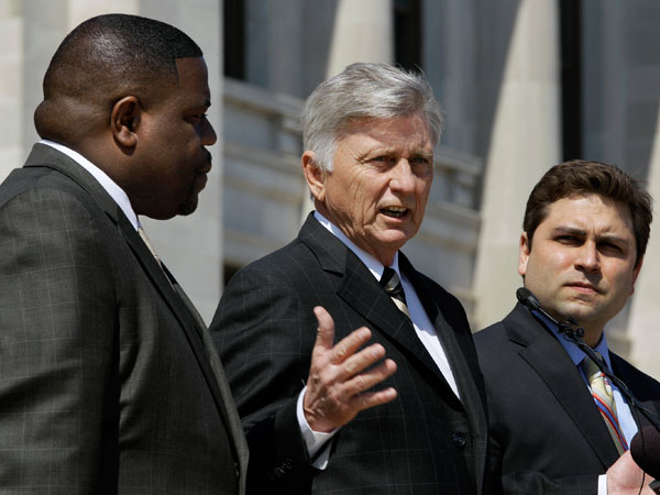 Arkansas Gov. Mike Beebe, center, speaks at a rally in front of the Arkansas state Capitol in Little Rock, Ark., promoting the expansion of Medicaid in the state as Sen. Jonathan Dismang, R-Beebe, right, and Rep. Reginald Murdock, D-Marianna, listen Thursday, March 7, 2013. (AP Photo/Danny Johnston)