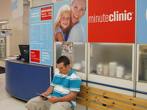 Andy Duppler, 16, awaits his turn at a MinuteClinic in Maple Grove, Minn. on Tuesday, May 31, 2005. MinuteClinics are cropping up in grocery stores and CVS Pharmacies, offering medical attention for minor ailments, such as flu, sore throats and colds. (AP Photo/Janet Hostetter)