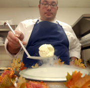 Matthew Levin flash freezes (with nitrogen) a coconut curry foam with citrus gelee inside in the kitchen of Lacroix. (Bonnie Weller / Inquirer)