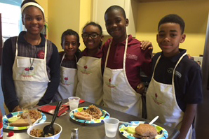 Sanai Henry, Mariem Cherifahmed, Myla Baxter, Nahmir Fleming, and Sean Green display the quick pickles and turkey sloppy joes that they made during Week 2 of My Daughter's Kitchen at Philadelphia Mont