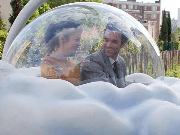 """Colin and Chlo (Romain Duris and Audrey Tautou) on an adventure in a cloud-shaped gondola car in """"Mood Indigo."""""""