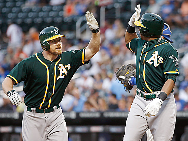 The Athletics´ Brandon Moss greets Yoenis Cespedes at the plate after a home run. (Kathy Willens/AP)