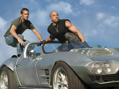 "Paul Walker, left, and Vin Diesel in ""Fast Five."""