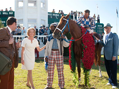 "From left: Diane Lane, Nelsan Ellis, Otto Thorwarth, and John Malkovich are shown in a scene from, ""Secretariat."" Lane plays the stallion's owner, Malkovich its trainer."