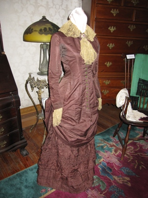 This dress is a part of the Gloucester Museum´s exhibit. This ciirca 1870's side-saddle riding outfit and matching hat with attached veil is a part of the collection.