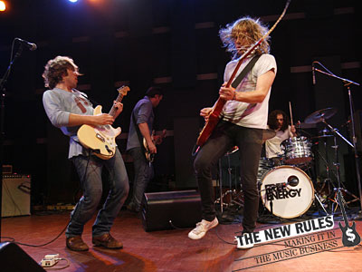 Free Energy at World Cafe Live: From left, Geoff Bucknum (guitar), Evan Wells (bass), Scott Wells (guitar) and Nicholas Shuminsky (drums). Live gigs are a big part of the band´s efforts to amp up its earnings.