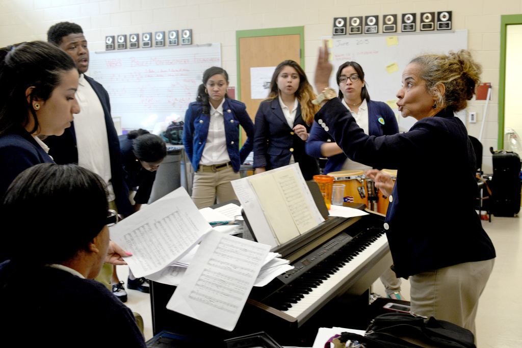 Suzzette Ortiz conducts rehearsal for her singers. She started teaching in Camden schools in 1986. TOM GRALISH / Staff Photographer