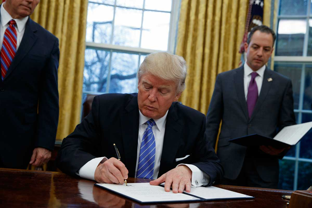 President Trump signs an executive order last month to withdraw the United States from the Trans-Pacific Partnership, a pact that attempted to make trade fairer.<br />