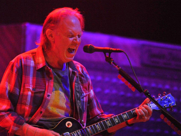 Rocker Neil Young in November 2012 playing with the band Crazy Horse at the Wells Fargo Center in Philadelphia.<br />