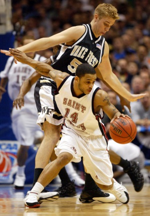 Jameer Nelson dribbles the ball while defended by Wake<br />Forest&acute;s Kyle Visser during the 2004 East Rutherford<br />Regional Semifinal. (Staff photo)
