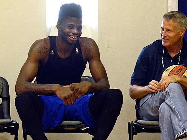 76ers center Nerlens Noel talks with coach Brett Brown. (Tom Gralish/Staff Photographer)