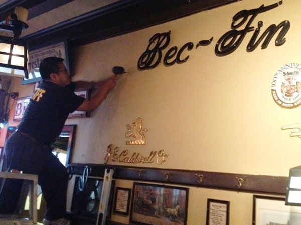 Le Bec-Fin letters go up on wall of McGillin´s Old Ale House.