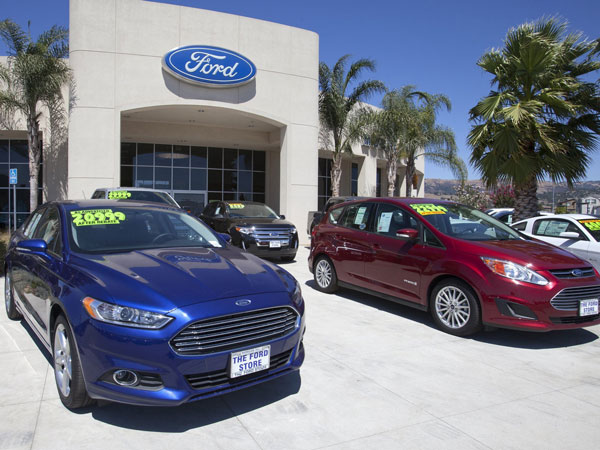 A Ford Fusion, left, and a C-Max Hybrid  are displayed at The Ford Store in Morgan Hill, Calif., in August 2013. (Patrick Tehan/San Jose Mercury News/MCT)