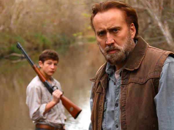 """Tye Sheridan sports the firearm, Nicolas Cage sports the look of woe, in """"Joe."""""""