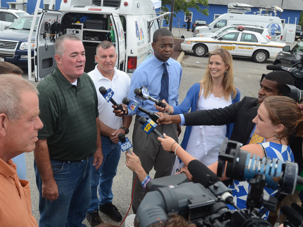 A $448 million Powerball jackpot was hit by three tickets in early August 2013. New Jersey sold two of them, including one bought for 16 workers at the Ocean County Vehicle Services Department. Its director, James Pine (green shirt) spoke with the media on Aug. 9, 2013. (Tom Kelly lll / For the Inquirer)