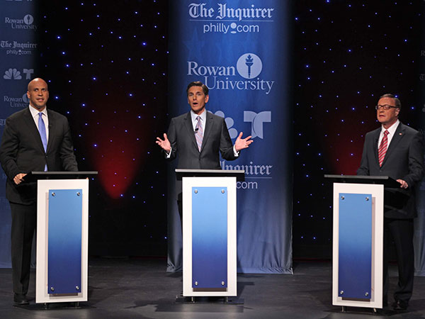 U.S. Senate candidates Cory Booker (left) and Steve Lonegan in their second televised debate moderated by Tim Rosenfield, NBC 10, at Pfleeger Concert Hall, Wilson Hall, Rowan University, Glassboro, N.J., October 9, 2013.  (Pool Photo/Philadelphia Inquirer, Michael Bryant)