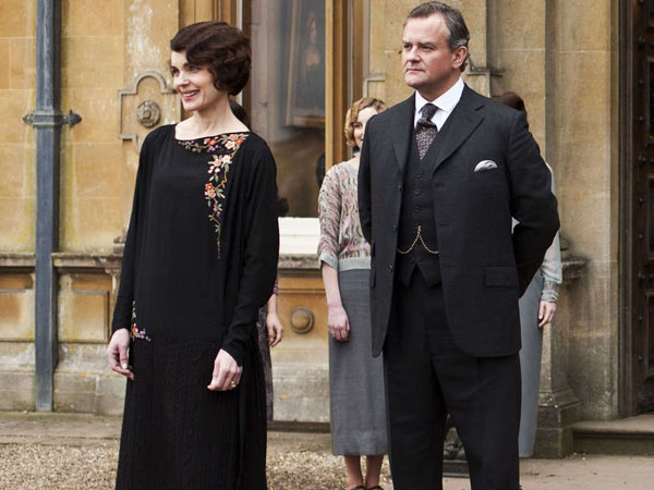 """This undated publicity photo provided by PBS shows, from left, Elizabeth McGovern as Lady Grantham, Hugh Bonneville as Lord Grantham, Dan Stevens as Matthew Crawley, Penelope Wilton as Isobel Crawley, Allen Leech as Tom Branson, Jim Carter as Mr. Carson, and Phyllis Logan as Mrs. Hughes, from the TV series, """"Downton Abbey.""""  The program was nominated for an Emmy Award for outstanding drama series on, Thursday July 18, 2013. The Academy of Television Arts & Sciences´ Emmy ceremony will be hosted by Neil Patrick Harris. It will air Sept. 22 on CBS. (AP Photo/PBS, Carnival Film & Television Limited 2012 for MASTERPIECE, Nick Briggs)"""
