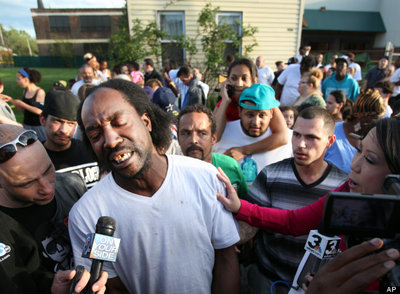 Neighbor Charles Ramsey speaks to media near the home on the 2200 block of Seymour Avenue, where three missing women were rescued in Cleveland, on Monday, May 6, 2013. (AP Photo/The Plain Dealer, Scott Shaw)