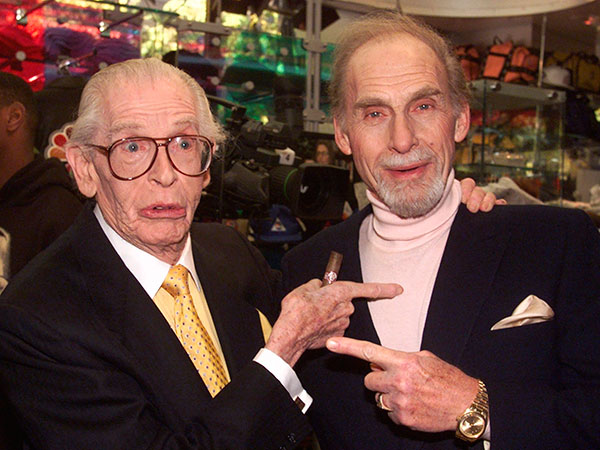 "FILE - This Oct. 25, 1999 file photo shows Milton Berle, left, and Sid Caesar before being honored in as the first inductees into NBC´s ""Walk of Fame"" in the network´s Rockefeller Center store in New York. Caesar, whose sketches lit up 1950s television with zany humor, died Wednesday, Feb. 12, 2014. He was 91.  (AP Photo/Richard Drew, File)"