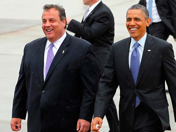 New .Jersey Gov. Chris Christie and President Barack Obama walk over to a gallery to meet visitors at McGuire Air Force Base,, N.J. Tuesday, May 28, 2013. The President and Governor left for an appearance at Asbury Park, one of the many Jersey shore communities devastated by Super Storm Sandy. (AP Photo/Rich Schultz)