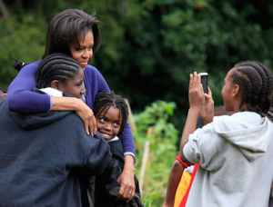 Michelle Obama poses for a photo at the White House garden harvest. (via Huffington Post)