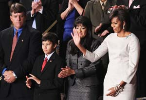 photo courtesy of Rachel Roy. We like Mrs. Obama in this silvery grey shift. What do you think?