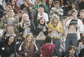 Student supporters of Barak Obama from Abington High School painted their stomachs with his name.