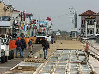 Ocean City public works employees work to refurbish a portion of the boardwalk last March. The original plan was to use the controversial South American rainforest wood Ipe but things got messy. (Clem Murray / Staff Photographer)