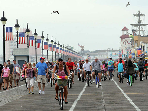 Pedestrians and bike riders enjoy the Ocean City Boardwalk. Ocean City also won the crown in 2009. (Yong Kim/Staff/File)