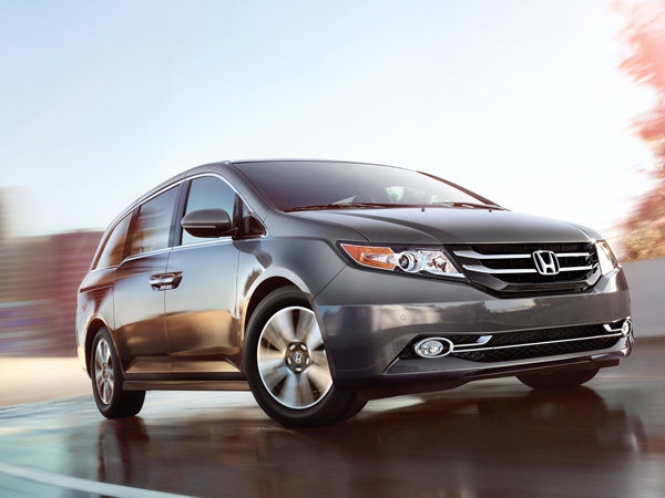 The 2014 Honda Odyssey offers such interior amenities as a built-in vacuum. (Honda/MCT)