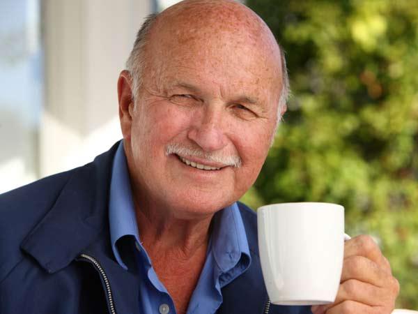 Elderly man enjoying his morning coffee.