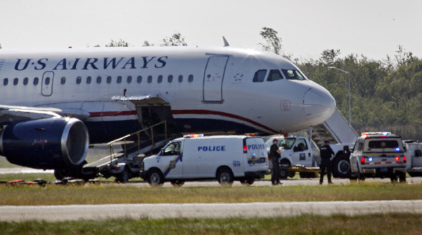 Philadelphia police were called to investigate a suspicious package on a US Airways plane at Philadelphia International Airport just before noon on Thursday. Passengers were taken off the plane before the search began.