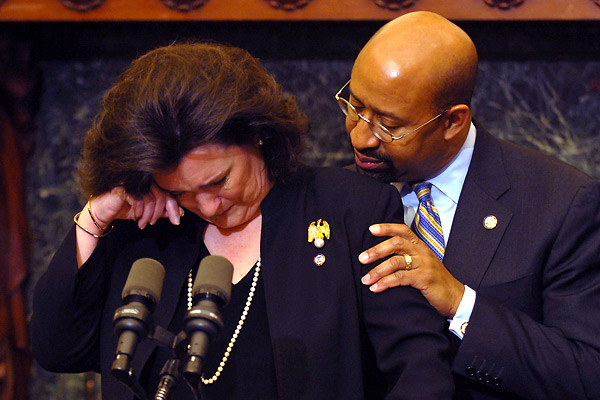 "Mayor Nutter comforts Philadelphia Managing Director Camille Barnett as she cries while recalling her husband´s death in the days just before she began the job. Barnett said this morning that she will resign effective June 30, saying she ""needs some time and space"" to work through the deep grief she feels for the death of her husband."