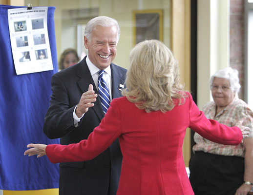 Democratic vice-presidential candidate Joe Biden exits the voting booth as his wife, Jill, waits after casting their votes near Biden´s home in Greenville, Del., early this morning.  (Laurence Kesterson / Staff Photographer)