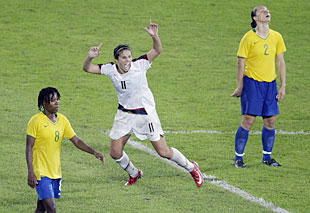 Carli Lloyd of Delran celebrates her goal in overtime of the Olympic gold medal game as Brazil´s Simone (2) and Brazil´s Formiga react.