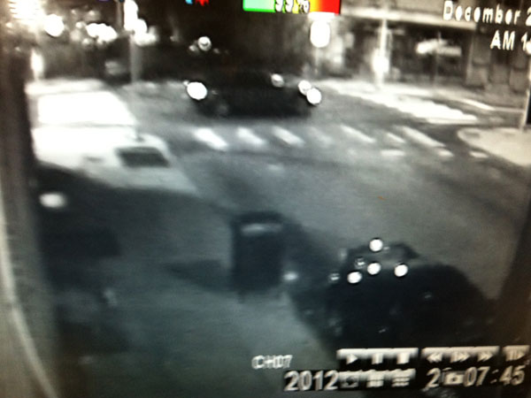 Police are seeking information on the driver and vehicle of this car that may have been involved in a hit and run Christmas Night in Kensington in the 3200 block of Frankford Avenue. Surveillance photo from Chuckles Bar.