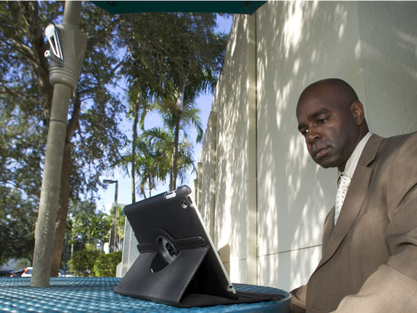 Vedner Guerrier,director of oncology services at Memorial Hospital West in Pembroke Pines, Florida, studies for his MBA during breaks and before and after work. (Joe Rimkus Jr./Miami Herald/MCT)