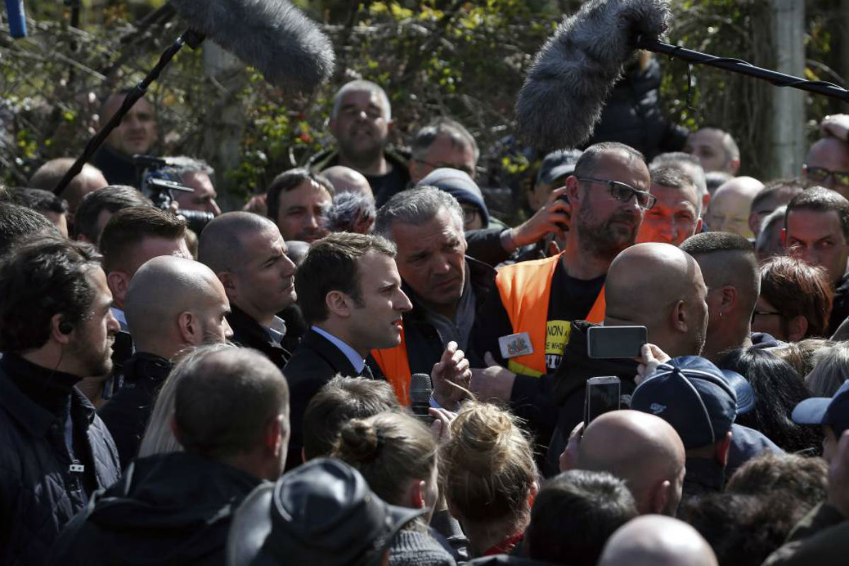 French centrist presidential election candidate Emmanuel Macron addresses workers at the Whirlpool home appliance factory Wednesday in northern France.