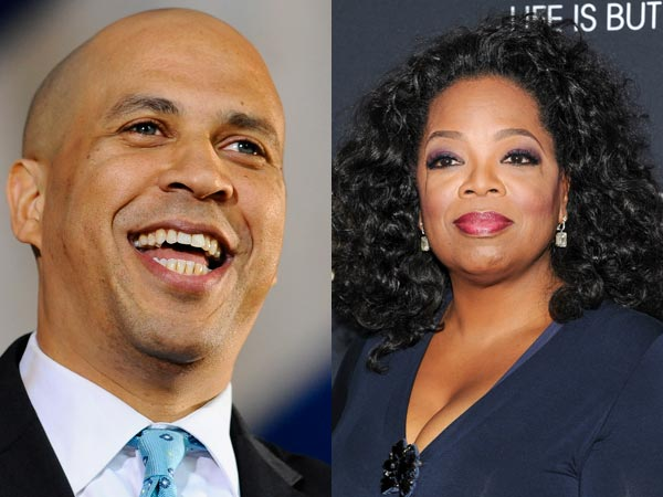 Newark Mayor Cory Booker raised money with Oprah Winfrey Thursday while his Democratic opponents were in his home city at a forum sponsored by the NAACP. (AP photos)