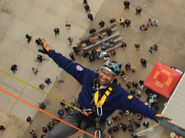 "Mayor Michael Nutter rappels down the face of the 31-story One Logan Square skyscraper at last year´s ""BUILDING ADVENTURE."""