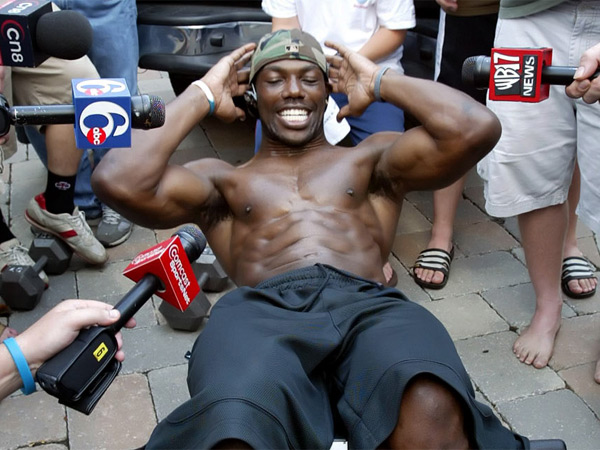 One of those famous Terrell Owens moments: The Eagles receiver did sit-ups in his Moorestown driveway, as the assembled media watched, in August 2005, After a disagreement, coach Andy Reid requested Owens leave training camp. (AP Photo/Joseph Kaczmarek)