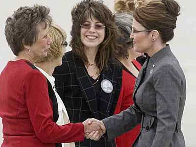 Republican volunteers from Montgomery County (from left) Eileen Petrille, Corinne Morgan, Traci Dallas-Opdahl, Mary Obel and Joanne Markey (hidden), meet Alaska Governor Sarah Palin on the tarmac in Philadelphia. (Jessica Griffin  / Inquirer)