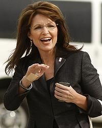 Palin, here arriving in Allentown, will meet Philly sports fans Saturday.