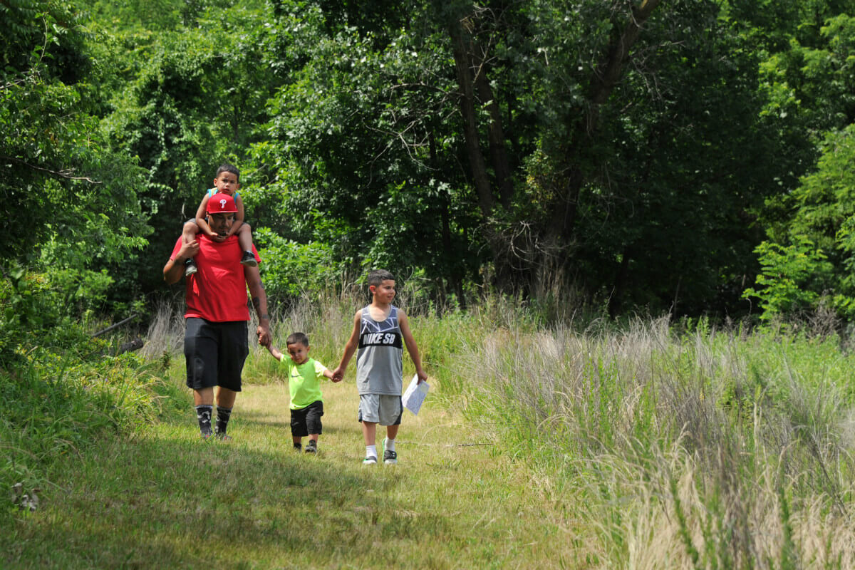 Fredde Rodriguez of Pennsauken hikes in Palmyra Cove Nature Park with his sons Juan (center) and Freddie Jr. (on shoulders) and nephew Joel Anaya.