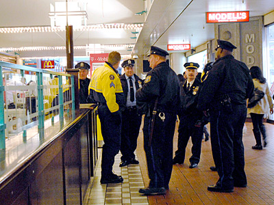 Officers patrol at the Gallery last month, one day after about 150 teens spilled out of the mall, rampaged through Macy´s and knocked down pedestrians. ( April Saul / Staff / File)