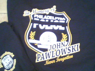 Detail on the T-shirts being sold in memory of Police Ofc. John Pawlowski, as a fund-raiser.